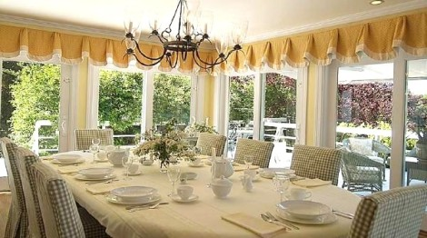 Dining room view 3 with white linens
