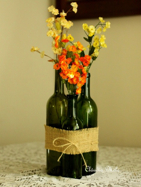 wine bottle cluster with burlap and flowers