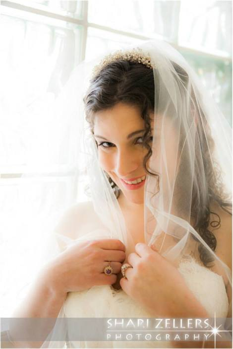 Bride and her veil by Shari