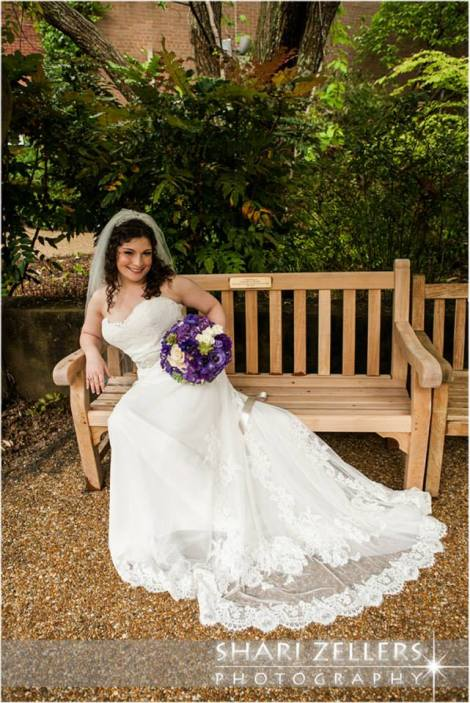 Bride on bench by Shari