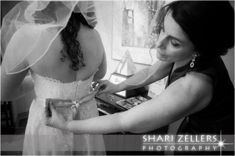 MOB fixing brides bow by Shari