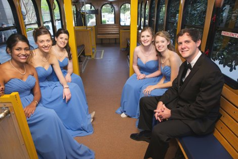 Bridesmaids and Brides brother on the Trolley going to the church