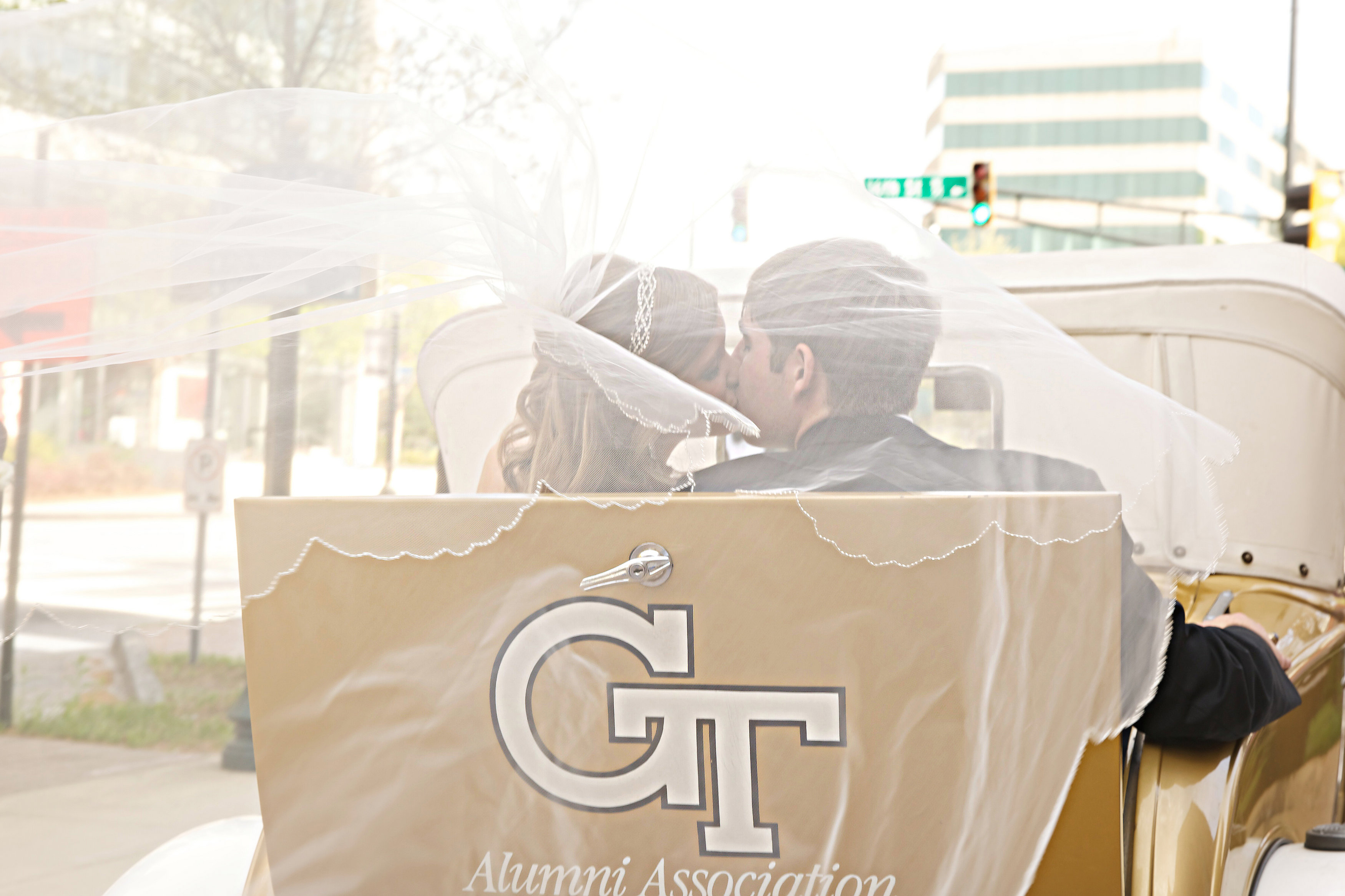 Kissing couple in the GT Ramblin Wreck