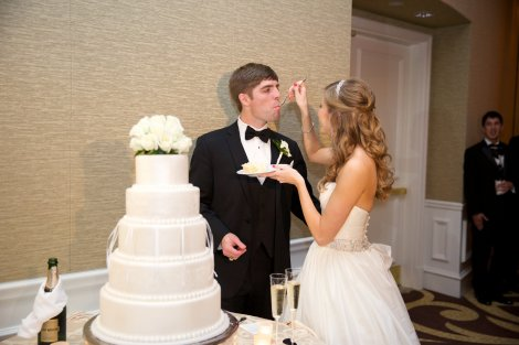 Bride feeding Groom