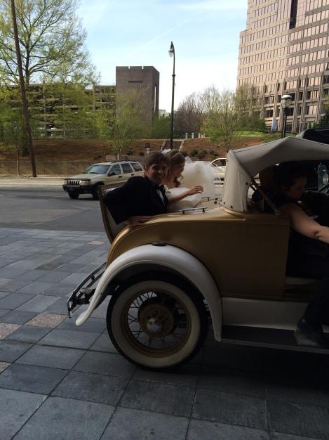 Bride & Groom in Rumble Seat of GT Ramblin Wreck