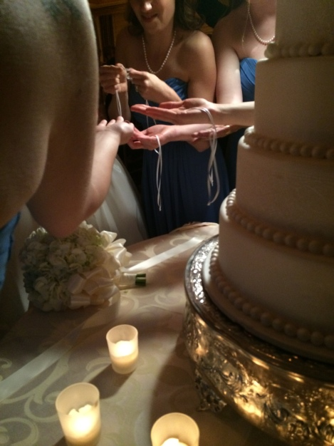 Cake Pull with Bridesmaids