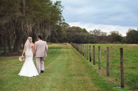 Couple walking beside pasture in Windsong Oak by Lauren Bates Photography