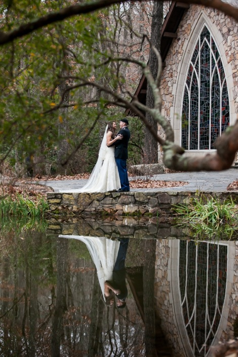 Bride and Groom with lake and Chapel