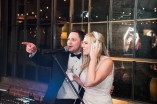 bride-and-groom-singing-at-dj-mic