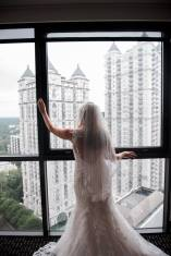 bride-looking-out-hotel-window
