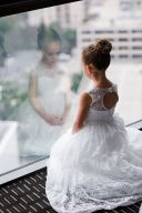 flower-girl-looking-out-window