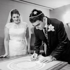 groom-signing-ketubah