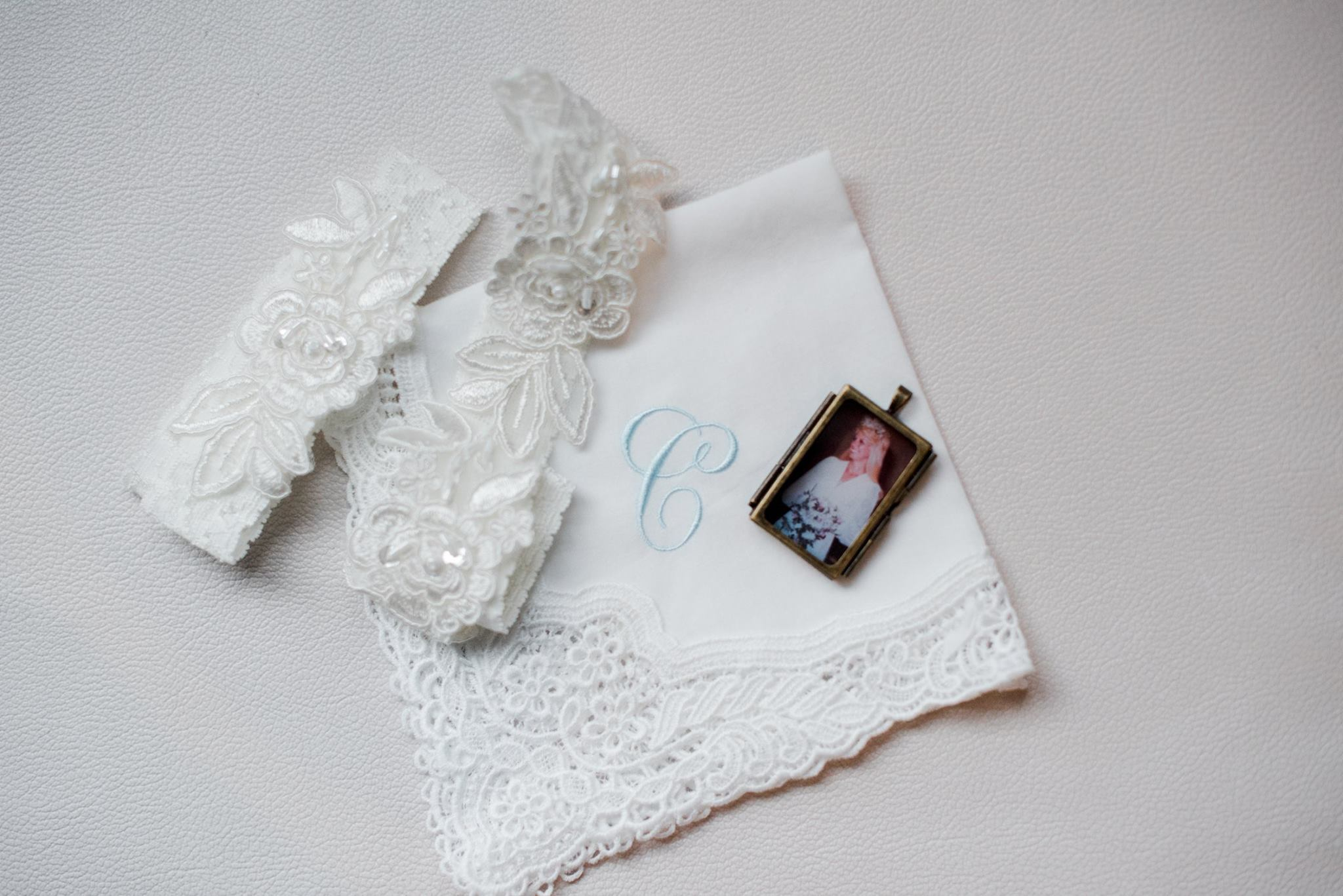 Garters, hanky and charm of brides mom